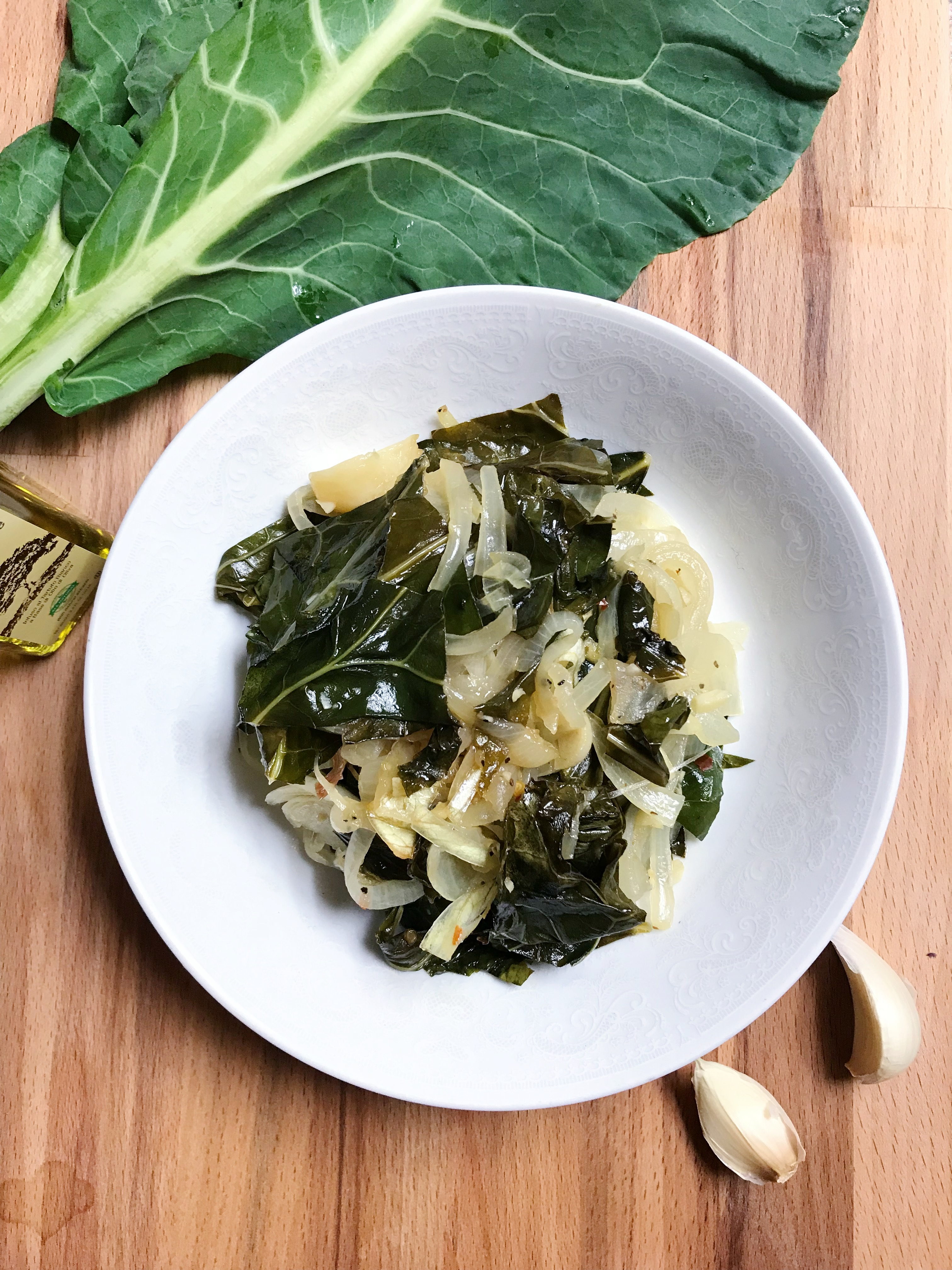 Collard Greens with Truffle Oil, Caramelized Onions, and Roasted Garlic